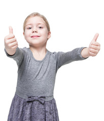 Beautiful little girl showing thumbs up isolated