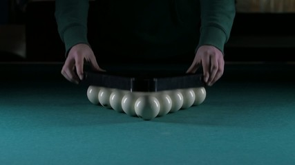 Triangle forms a pyramid of billiard balls. Slow motion