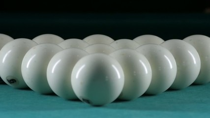 Triangle forms a pyramid of billiard balls. Close up. Slow