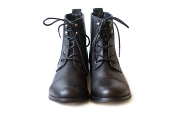 Pair of black boots on white background