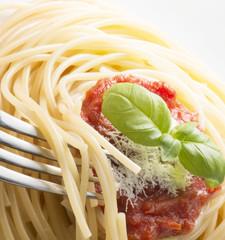 dish with spaghetti and tomato sauce
