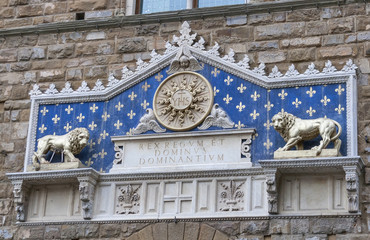 Ancient bass-relief on Uffizi museum wall in Florence
