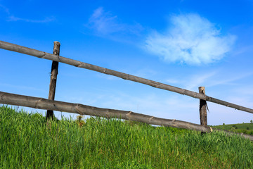 wooden fence on meadow