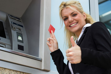 Cheerful businesswoman thumbs up