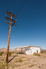 old power lines and abandoned building in the mojave desert
