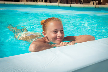 Young woman relaxing at pool