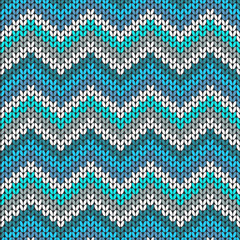 Knitted geometric pattern in blue, white and grey