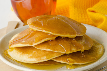 Agave syrup and a plate of pancakes.