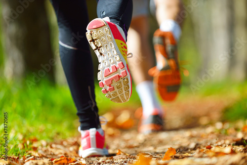 Young couple jogging in park at morning. Health and fitness. - 78720615