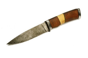 Old knife of Damascus steel - forged metal
