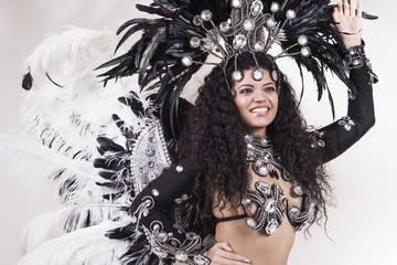 Beautiful samba dancer wearing traditional black and white costu