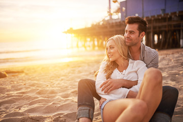 romantic couple having fun at santa monica on beach