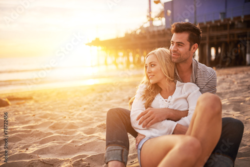 romantic couple having fun at santa monica on beach - 78722456