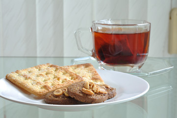 Cup of tea with cookie and bread, tea-break.