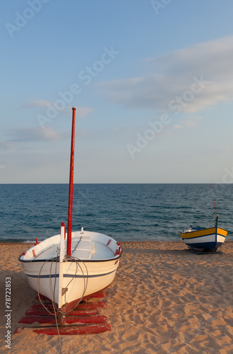 Pair of boats on the beach.