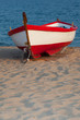 White with red stripe boat on the beach. - 78723002