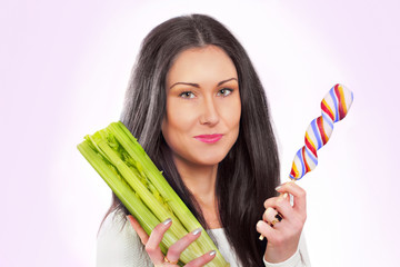 Pretty woman's healthier choice, celery or candy