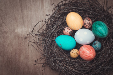 Colorful Easter eggs in a nest in a rustic style and place for t
