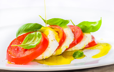 Mozzarella and tomatoes, caprese salad.Italian cuisine.