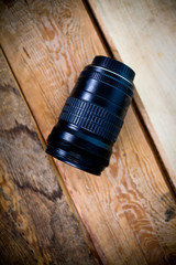 Profesialny lens on a wooden background