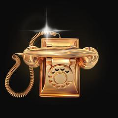 Golden phone on black background.