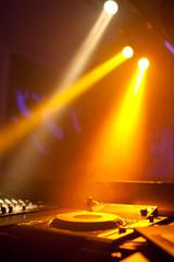 Spotlights shines at dj turntable