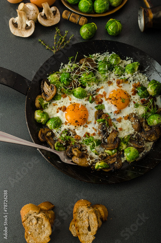 Vegetable omelet with bulls eye egg and sprouts - 78726288