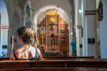 Young Girl praying in a San Cristobal Church, Traveling Mexico.