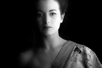 Beautiful woman dressed in a kimono, monochrome