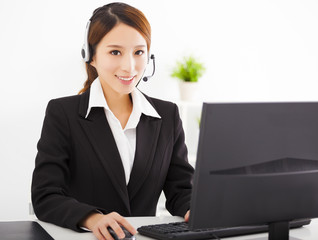 young beautiful asian businesswoman with headset in office