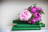 Wedding bouquet of a pink peonies, tulips and lily of the valle