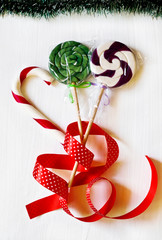 Christmas sweets and decorations on a white background
