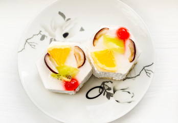 Delicious cake with fruits on a plate