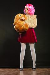 childlike woman and big dog toy