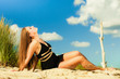 canvas print picture - Woman sunbathing on beach.