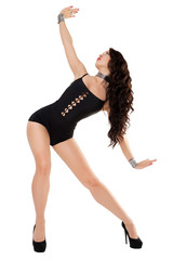 Sexy woman with long hair. Model dancing in black swimsuit.