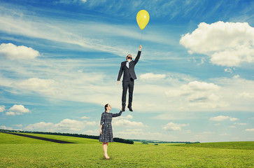 beautiful woman holding flying man
