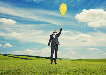 man flying with balloon at outdoor