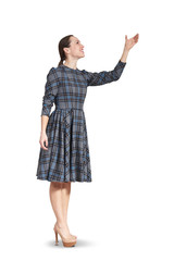woman looking up and raising her hand