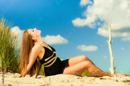 canvas print picture Woman sunbathing on beach.