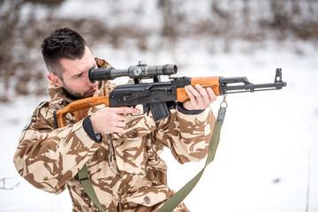 military trooper holding gun and shooting enemies