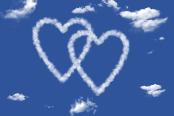 blue sky with hearts shape clouds.