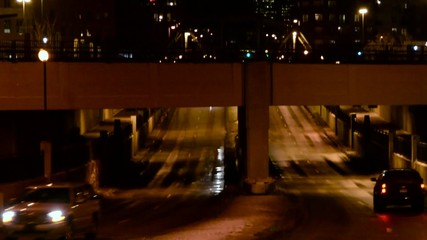 Traffic going under an underpass in the city at night