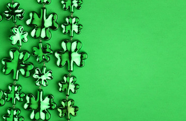 Shamrock Shaped Shiny Leaves over Green. St. Patrick's Day