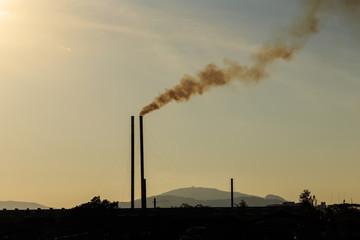 Smokestacks at sunset time