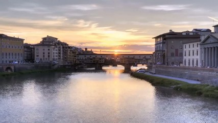Sunset on a background of the river Arno in Florence