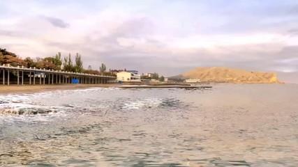 Coast of Black sea and beach are in city Sudak