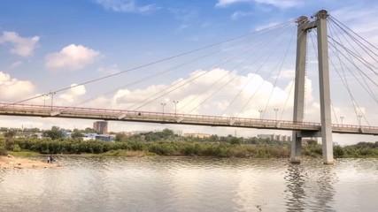Footbridge over the flow of the Yenisei river