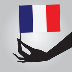Hand with France flag