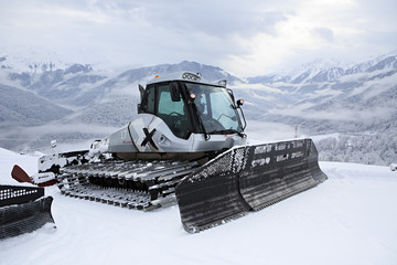 Plow snow removal equipment in the mountains of Roza Khutor